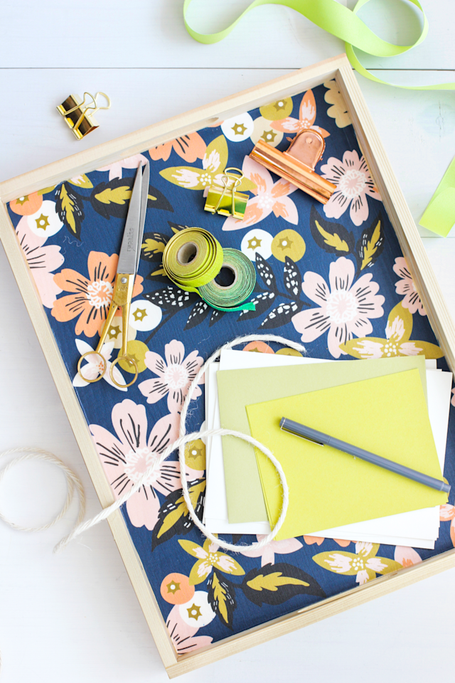 "<p>An all-purpose organizer, this tray is perfect for doing homework on the couch or tidying up school supplies. </p><p><em>Get the tutorial at <a href=""https://www.aliceandlois.com/diy-fabric-lined-wood-tray/"" target=""_blank"">Alice & Lois</a>.</em></p><p><em></em><strong>What you'll need: </strong><a href=""https://www.etsy.com/listing/696493235/rifle-paper-co-wildwood-cotton-lawn"" target=""_blank"">Floral fabric</a> ($8, etsy.com)</p>"