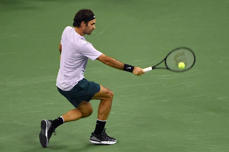 Roger Federer of Switzerland hits a return against Rafael Nadal of Spain during their men's singles final match at the Shanghai Masters tennis tournament in Shanghai on October 15, 2017. (AFP Photo/Chandan KHANNA)