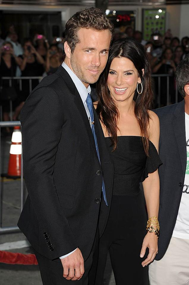 "Sandra Bullock surprised Ryan Reynolds (her co-star in the 2009 flick ""The Proposal"") on the red carpet at the L.A. premiere of his new comedy ""The Change-Up"" on Sunday night. She's not even in the movie and she's <i>still</i> stealing the show! Jason Merritt/<a href=""http://www.gettyimages.com/"" target=""new"">GettyImages.com</a> - August 1, 2011"
