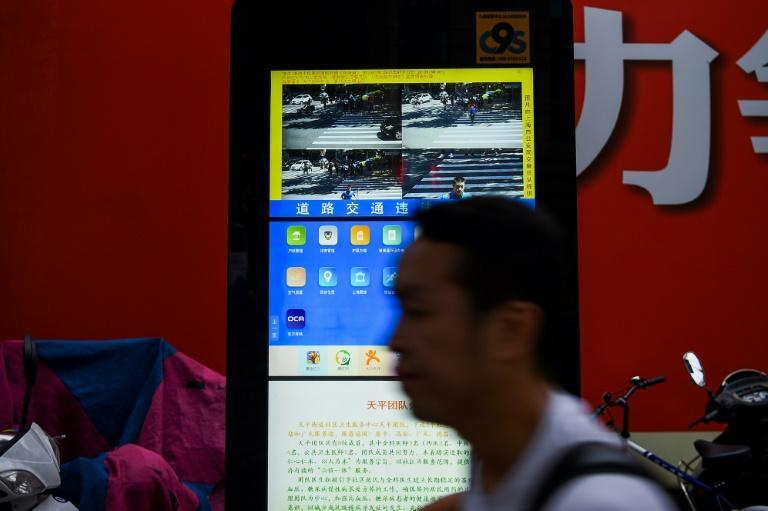 Facial recognition is used by law enforcement around the world, including in China, where activists say it may help authorities carry out human rights abuses (AFP Photo/CHANDAN KHANNA)