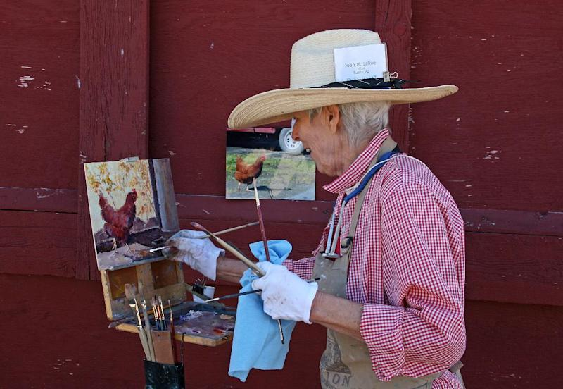 This Aug. 20, 2011 photo shows Joan LaRue of Tucson, Ariz., participating in Quick Draw at the Sieben Ranch north of Helena, Mont. Quick Draw,  an event in which artists create works outdoors in public in a matter of hours, is part of an annual August art festival called the Western Rendezvous of Art centered in Helena. (AP Photo/Ron Zellar)