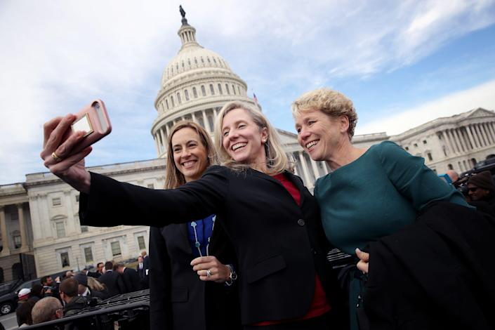 Newly elected Democratic members of the House of Representatives Abigail Spanberger or Virginia (C), Mikie Sherrill (L) of New Jersey and Chrissy Houlahan of Pennsylvania take a selfie in front of the U.S. Capitol following an official class picture of new representatives on November 14, 2018 in Washington, D.C.