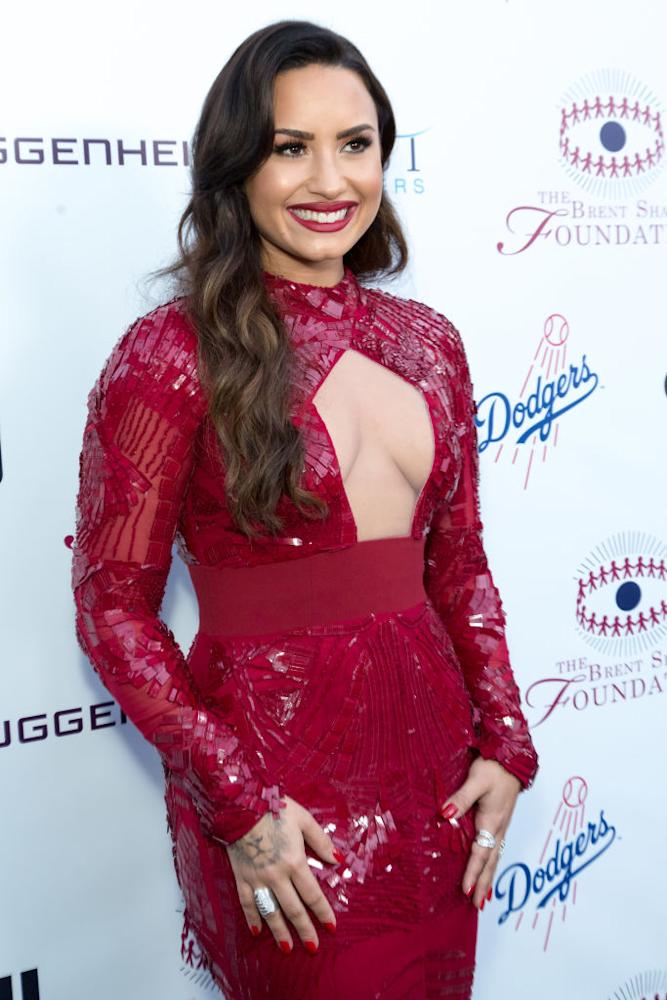 Demi Lovato\'s red dress has a chest cut-out and it\'s very DRAMA