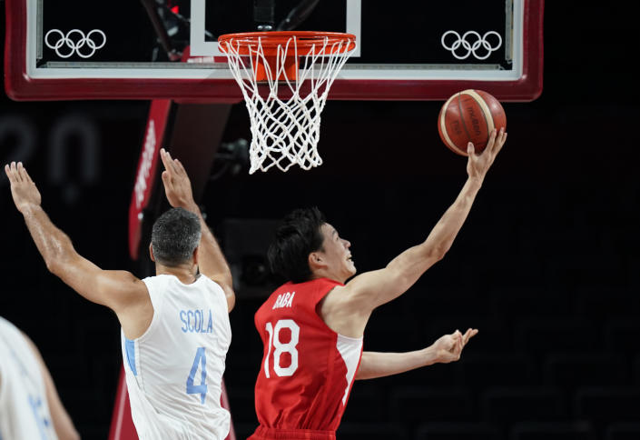 Japan's Yudai Baba (18), right, drives to the basket past Argentina's Luis Scola (4) during men's basketball preliminary round game at the 2020 Summer Olympics, Sunday, Aug. 1, 2021, in Saitama, Japan. (AP Photo/Charlie Neibergall)