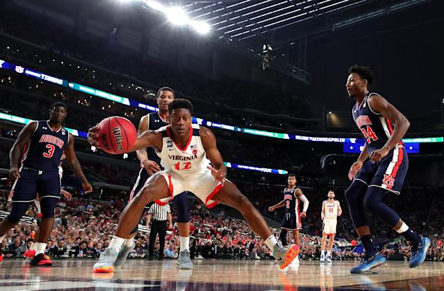 De'Andre Hunter #12 of the Virginia Cavaliers handles the ball in the first half against the Auburn Tigers during the 2019 NCAA Final Four semifinal at U.S. Bank Stadium on April 6, 2019 in Minneapolis, Minnesota. (Photo by Tom Pennington/Getty Images)