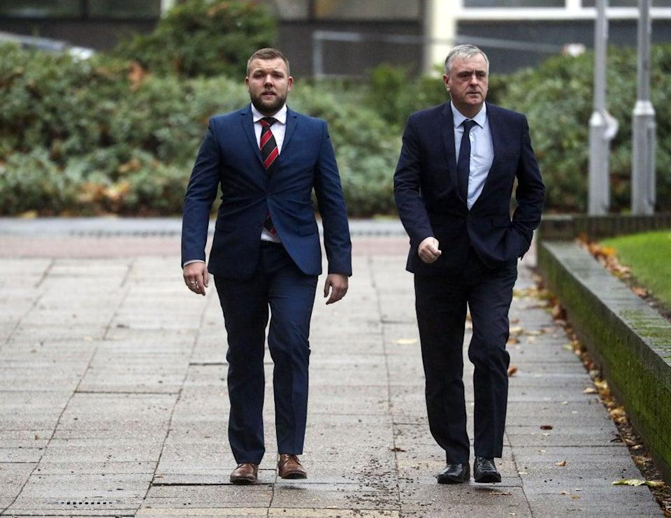 Birmingham-based Pc Declan Jones (left) arriving at Coventry Magistrates' Court fora previous hearing (Steve Parsons/PA) (PA Archive)