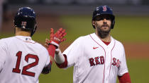 Boston Red Sox's J.D. Martinez, right, is congratulated by Marwin Gonzalez (12) after scoring on a single by Christian Vazquez during the first inning of a baseball game against the Detroit Tigers at Fenway Park, Tuesday, May 4, 2021, in Boston. (AP Photo/Charles Krupa)