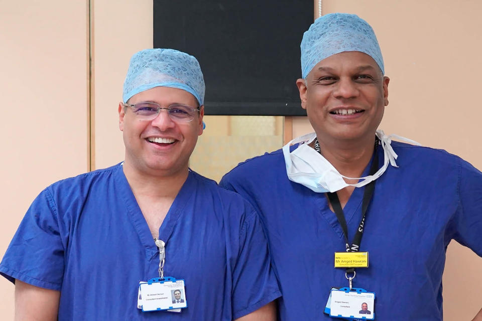 In this photo taken in early 2020 Dr. Amged El-Hawrani poses for a photo with his friend and colleague Dr Ahmed Haroun. During a pandemic, heroes wear scrubs. Amged El-Hawrani was one of them, a doctor who went to work every day as the coronavirus pandemic took hold even though he might be exposed, risking his own life. The 55-year-old died on March 28, becoming one of the first doctors in Britain's National Health Service to succumb to COVID-19 and a symbol of the acute danger all health workers brave. (Amged El-Hawrani via AP)