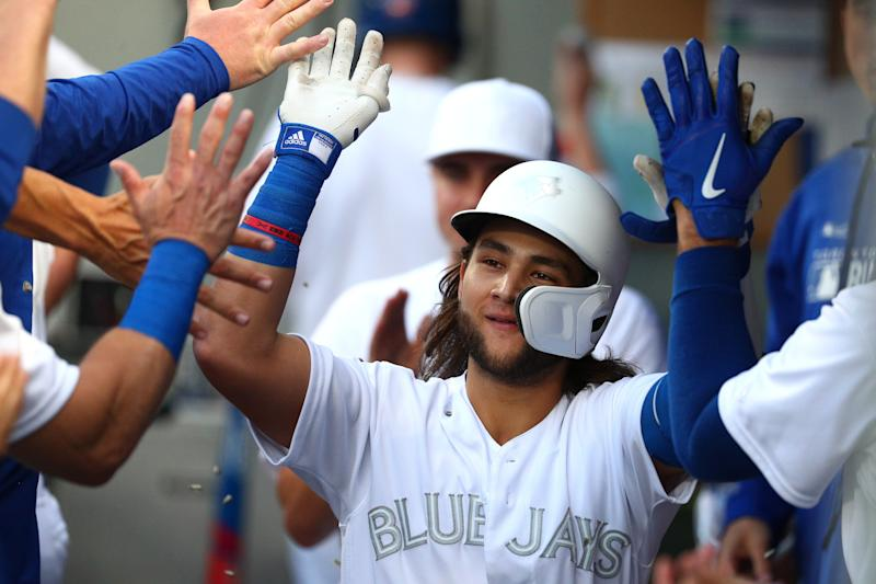SEATTLE, WASHINGTON - AUGUST 24: Bo Bichette #11 of the Toronto Blue Jays celebrates after hitting a solo home run against the Seattle Mariners in the third inning during their game at T-Mobile Park on August 24, 2019 in Seattle, Washington. Teams are wearing special color schemed uniforms with players choosing nicknames to display for Players' Weekend. (Photo by Abbie Parr/Getty Images)