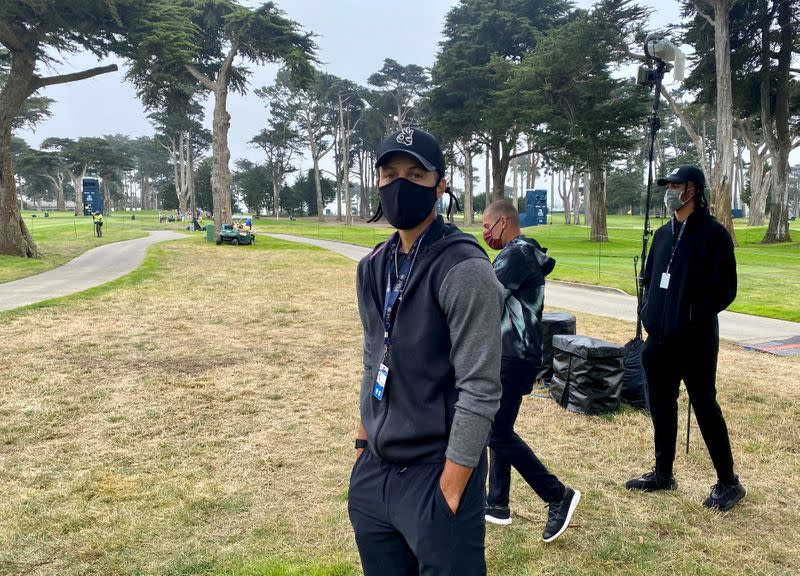 Golden State Warriors guard Stephen Curry takes in the action at the PGA Championship at TPC Harding Park, amid the global outbreak of the coronavirus disease (COVID-19), in San Francisco, California