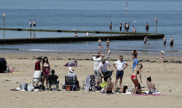 People settle to enjoy the good weather on the beach in Margate, Kent, after the introduction of measures to bring the country out of lockdown. (AP)