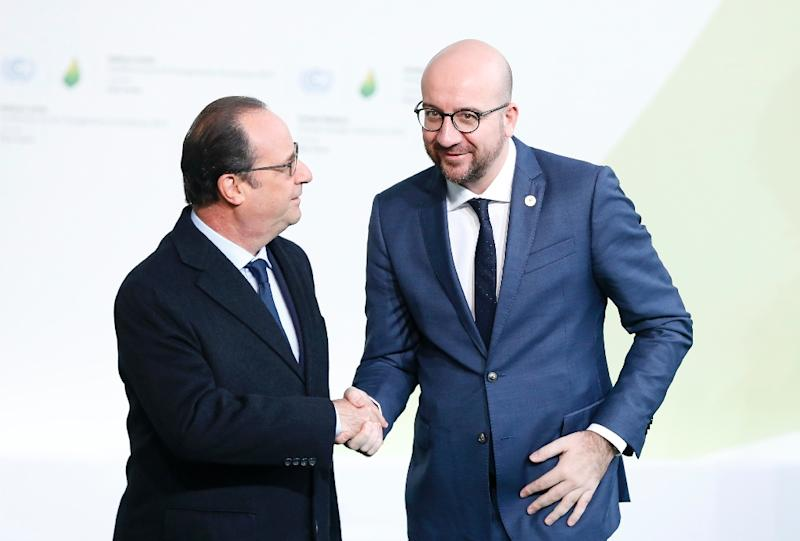French president Francois Hollande (L) greets Belgium prime minister Charles Michel (R) as he arrives for the COP21 World Climate Change Conference in Le Bourget, north of Paris, on November 30, 2015