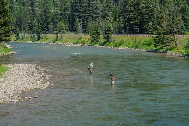Two anglers cast their lines on the Gallatin River south of Bozeman, Montana. (Photo: DianeBentleyRaymond via Getty Images)