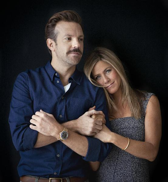"""FILE - In this July 27, 2013 file photo, actor Jason Sudeikis, left, and actress Jennifer Aniston pose for a portrait as they promote the movie """"We're the Millers"""" in New York. The film opens nationwide on Wednesday, Aug. 7. (Photo by Carlo Allegri/Invision/AP, File)"""