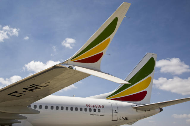The winglet of an Ethiopian Airlines Boeing 737 Max 8 is seen as it sits grounded at Bole International Airport in Addis Ababa, Ethiopia Saturday, March 23, 2019. The chief of Ethiopian Airlines says the warning and training requirements set for the now-grounded 737 Max aircraft may not have been enough following the Ethiopian Airlines plane crash that killed 157 people. (AP Photo/Mulugeta Ayene)