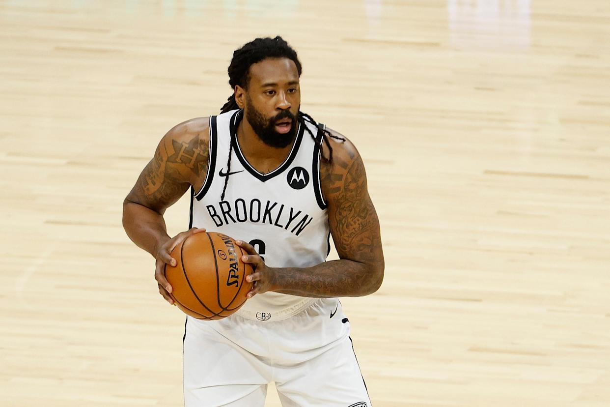 PHOENIX, ARIZONA - FEBRUARY 16: DeAndre Jordan #6 of the Brooklyn Nets handles the ball against the Phoenix Suns during the NBA game at Phoenix Suns Arena on February 16, 2021 in Phoenix, Arizona. The Nets defeated the Suns 128-124. NOTE TO USER: User expressly acknowledges and agrees that, by downloading and or using this photograph, User is consenting to the terms and conditions of the Getty Images License Agreement. (Photo by Christian Petersen/Getty Images)