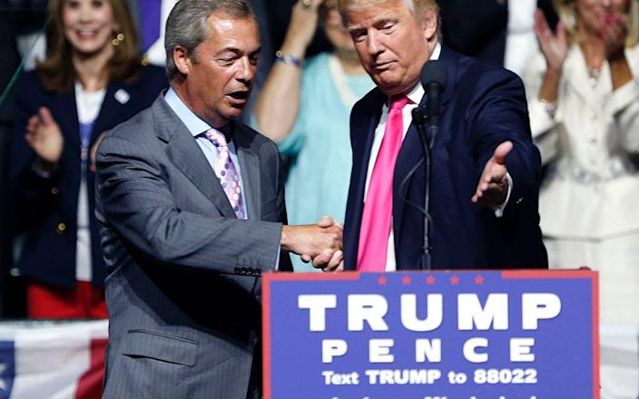 Donald Trump welcomes Nigel Farage to the stage at a rally in MIssissippi in August 2016