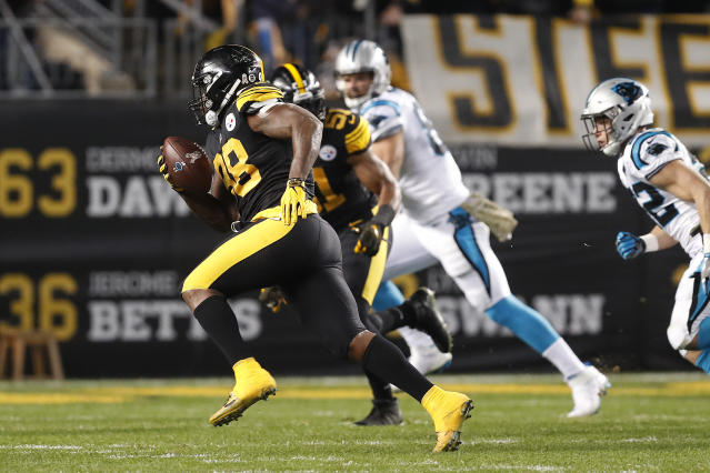 Pittsburgh Steelers inside linebacker Vince Williams (98) returns an interception for a touchdown during the first half of the team's NFL football game against the Carolina Panthers in Pittsburgh, Thursday, Nov. 8, 2018. (AP Photo/Keith Srakocic)