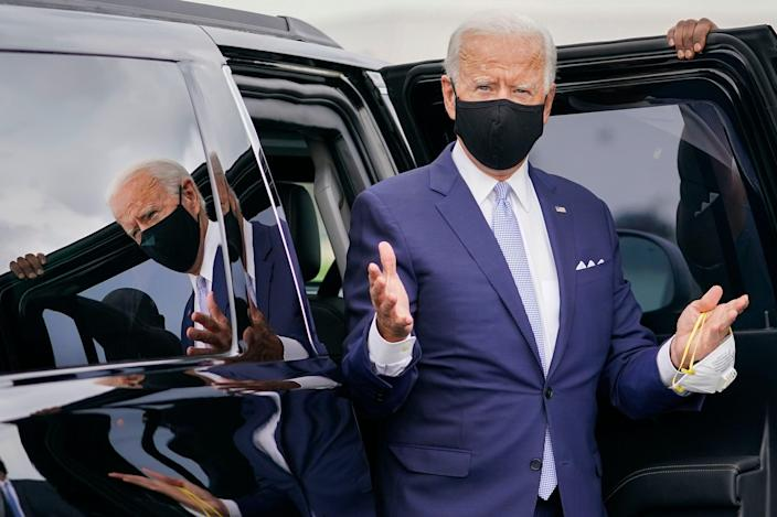 Democratic presidential candidate former Vice President Joe Biden gestures before boarding a plane at New Castle Airport in New Castle, Del., en route to speak at a campaign event in Pittsburgh, Pa., Monday, Aug. 31, 2020.