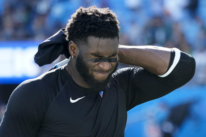 Carolina Panthers defensive end Brian Burns leaves the field after their loss against the Philadelphia Eagles in an NFL football game Sunday, Oct. 10, 2021, in Charlotte, N.C. (AP Photo/Jacob Kupferman)