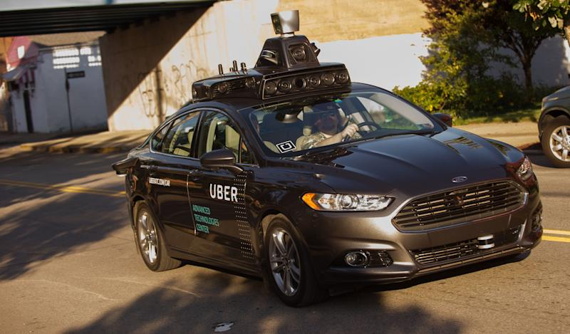 An Uber autonomous Ford Fusion drives through Pittsburgh in September 2016. The company, which now partners with Volvo, currently picks up and drops off riders from self-driving vehicles in only nine of Pittsburgh's 90 neighborhoods.