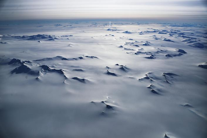 <p>Mountain peaks are seen from NASA's Operation IceBridge research aircraft in the Antarctic Peninsula region, on Nov. 4, 2017, above Antarctica. (Photo: Mario Tama/Getty Images) </p>