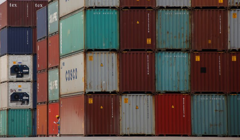 Japan exports to post double-digit fall again, machinery orders seen up: Reuters poll