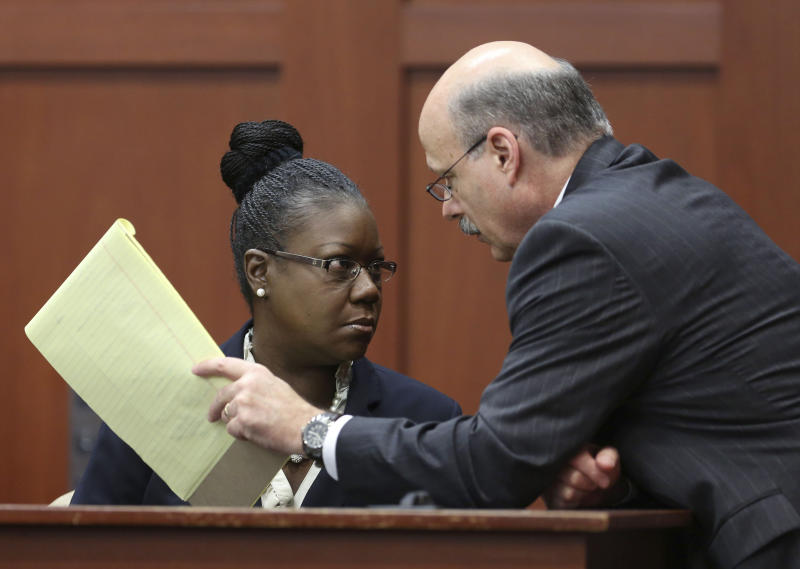 Assistant state attorney Bernie de la Rionda, right, talks to Sybrina Fulton, Trayvon Martin's mother, on the stand during a recess in George Zimmerman's trial in Seminole circuit court, Friday, July 5, 2013 in Sanford, Fla. Zimmerman has been charged with second-degree murder for the 2012 shooting death of Trayvon Martin. (AP Photo/Orlando Sentinel, Gary W. Green, Pool)
