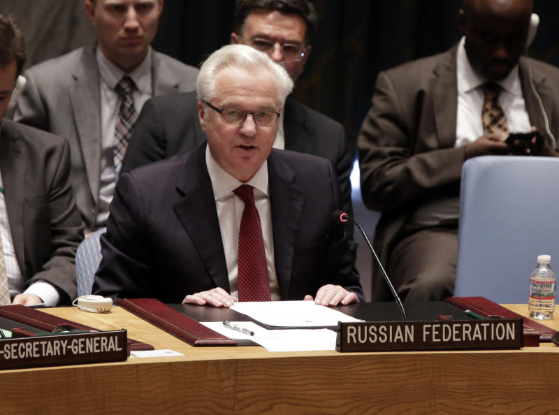 Russian Federation Ambassador Vitaly Churkin addresses the United Nations Security Council, Friday, May 2, 2014. The U.N. Security Council is meeting in emergency session on Ukraine after Russia called for a public meeting on the growing crisis there. (AP Photo/Richard Drew)