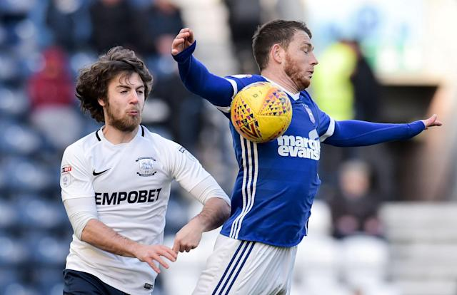 """Soccer Football - Championship - Preston North End vs Ipswich Town - Deepdale, Preston, Britain - February 24, 2018 Preston's Ben Pearson in action with Ipswich Town's Joe Garner Action Images/Paul Burrows EDITORIAL USE ONLY. No use with unauthorized audio, video, data, fixture lists, club/league logos or """"live"""" services. Online in-match use limited to 75 images, no video emulation. No use in betting, games or single club/league/player publications. Please contact your account representative for further details."""