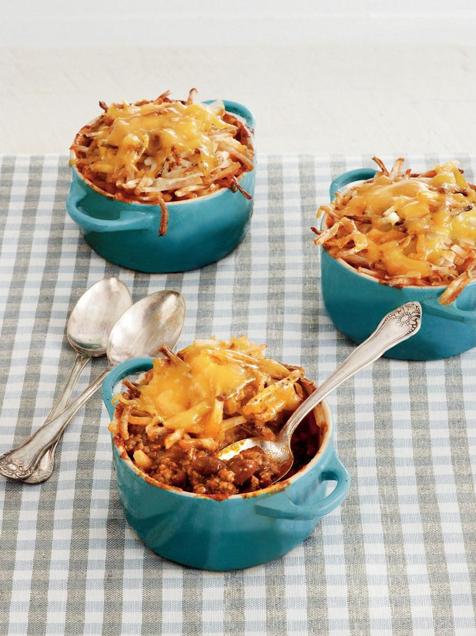 """<p><strong>Recipe: <a href=""""https://www.southernliving.com/recipes/cheesy-chili-hash-brown-bake-recipe"""" rel=""""nofollow noopener"""" target=""""_blank"""" data-ylk=""""slk:Cheesy Chili Hash Brown Bake"""" class=""""link rapid-noclick-resp"""">Cheesy Chili Hash Brown Bake</a></strong></p> <p>Store-bought shortcuts like a <a href=""""https://www.southernliving.com/veggies/potatoes/frozen-potato-recipes"""" rel=""""nofollow noopener"""" target=""""_blank"""" data-ylk=""""slk:bag of frozen potatoes"""" class=""""link rapid-noclick-resp"""">bag of frozen potatoes</a> can come in handy on busy nights, and this recipe only has four other easy ingredients. You can bake this hearty casserole in your 13x9 or individual ramekins for easy personal serving sizes.</p>"""