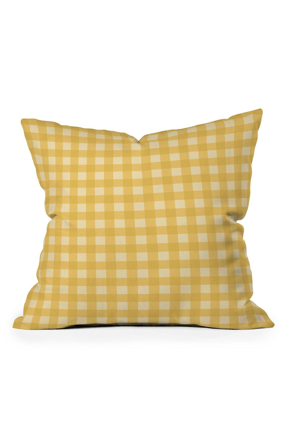 """A cottagecore confection rendered in classic gingham will lend countryside vibes to any couch or bed.<br><br><strong>DENY Designs</strong> Colour Poems Gingham Sunshine Square Throw Pillow, $, available at <a href=""""https://go.skimresources.com/?id=30283X879131&url=https%3A%2F%2Fwww.nordstromrack.com%2Fs%2Fdeny-designs-colour-poems-gingham-sunshine-square-throw-pillow%2F6021721"""" rel=""""nofollow noopener"""" target=""""_blank"""" data-ylk=""""slk:Nordstrom Rack"""" class=""""link rapid-noclick-resp"""">Nordstrom Rack</a>"""