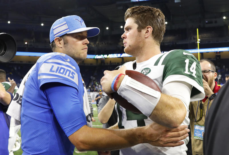 Detroit Lions quarterback Matthew Stafford, left, and New York Jets quarterback Sam Darnold talk after an NFL football game in Detroit, Monday, Sept. 10, 2018. The Jets won 48-17. (AP Photo/Rick Osentoski)