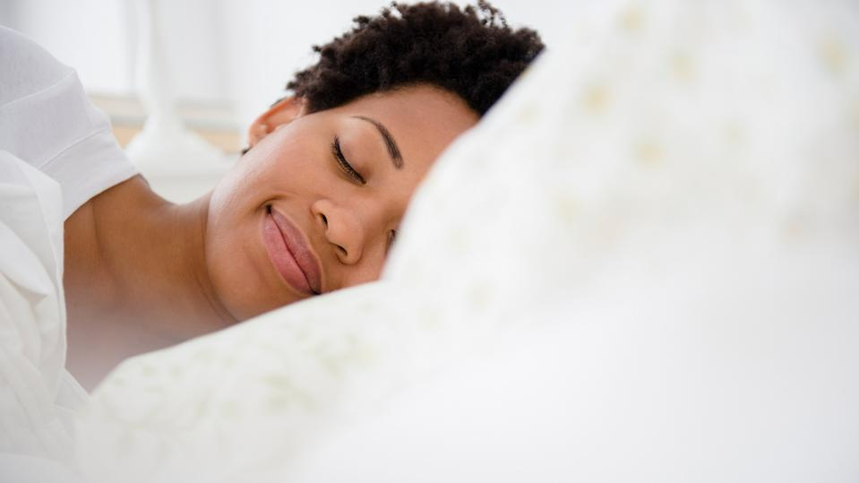 Creating a good bedtime routine will help you sleep better advises Dr Chris George (Image: Getty Images)