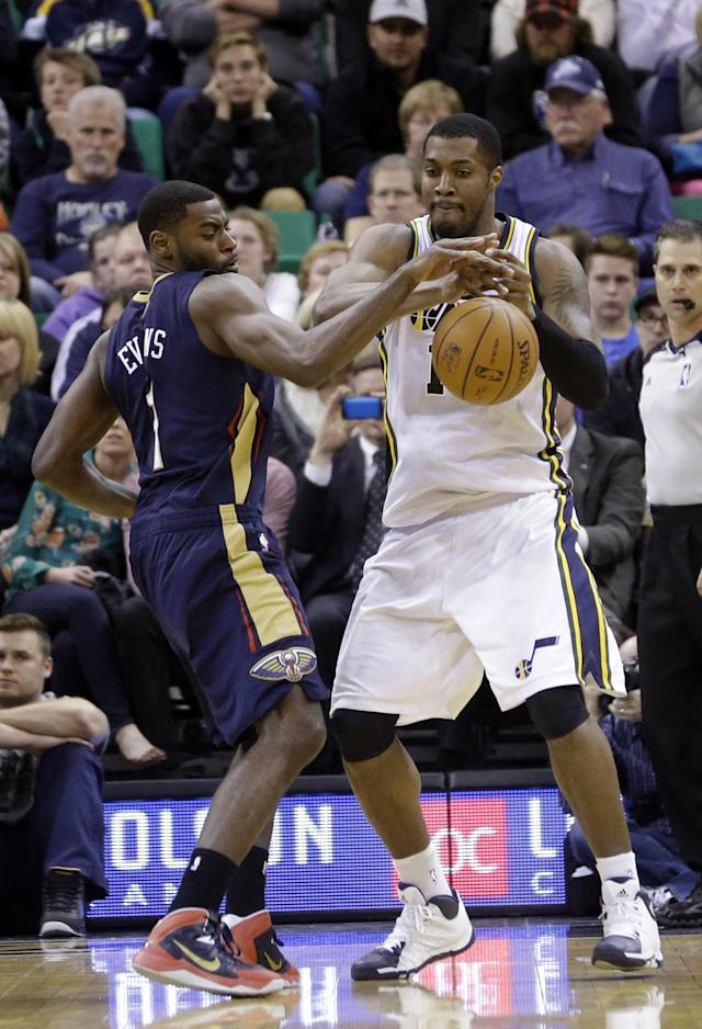 New Orleans Pelicans' Tyreke Evans, left, knocks the ball away from Utah Jazz's Derrick Favors, right, in the second quarter during an NBA basketball game on Friday, April 4, 2014, in Salt Lake City. (AP Photo/Rick Bowmer)