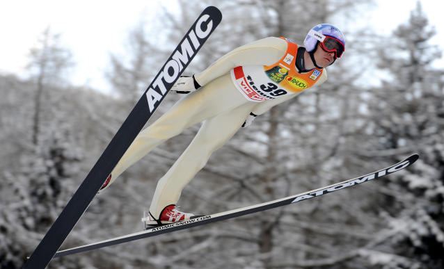 Bill Demong, of the United States, is airborne during the ski jumping phase of a men's World Cup Nordic Combined, in Predazzo, Italy, Friday, Feb. 3, 2012. (AP Photo/Armando Trovati)