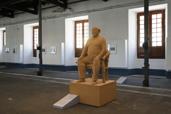 """Dissident Chinese artist Ai Weiwei's """"Brainless Figure in Cork"""" self-portrait sculpture made of cork, on display during a press preview of his new exhibition """"Rapture"""" in Lisbon, Thursday, June 3, 2021. The world-renowned artist is putting on the biggest show of his career, and he is doing it in a place he's fallen in love with: Portugal. (AP Photo/Armando Franca)"""