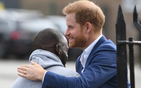 Prince Harry greeted by Trevor Rose as he arrives at the Community Recording Studio in Nottingham - Credit: PA