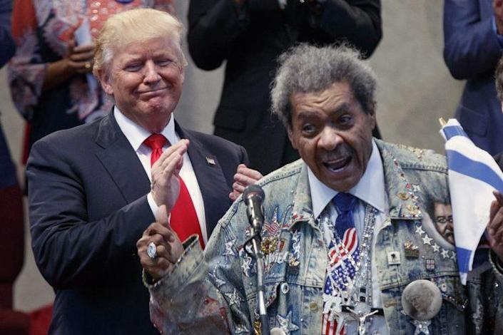 Boxing promoter Don King introduces Donald Trump at the New Spirit Revival Center in Cleveland.