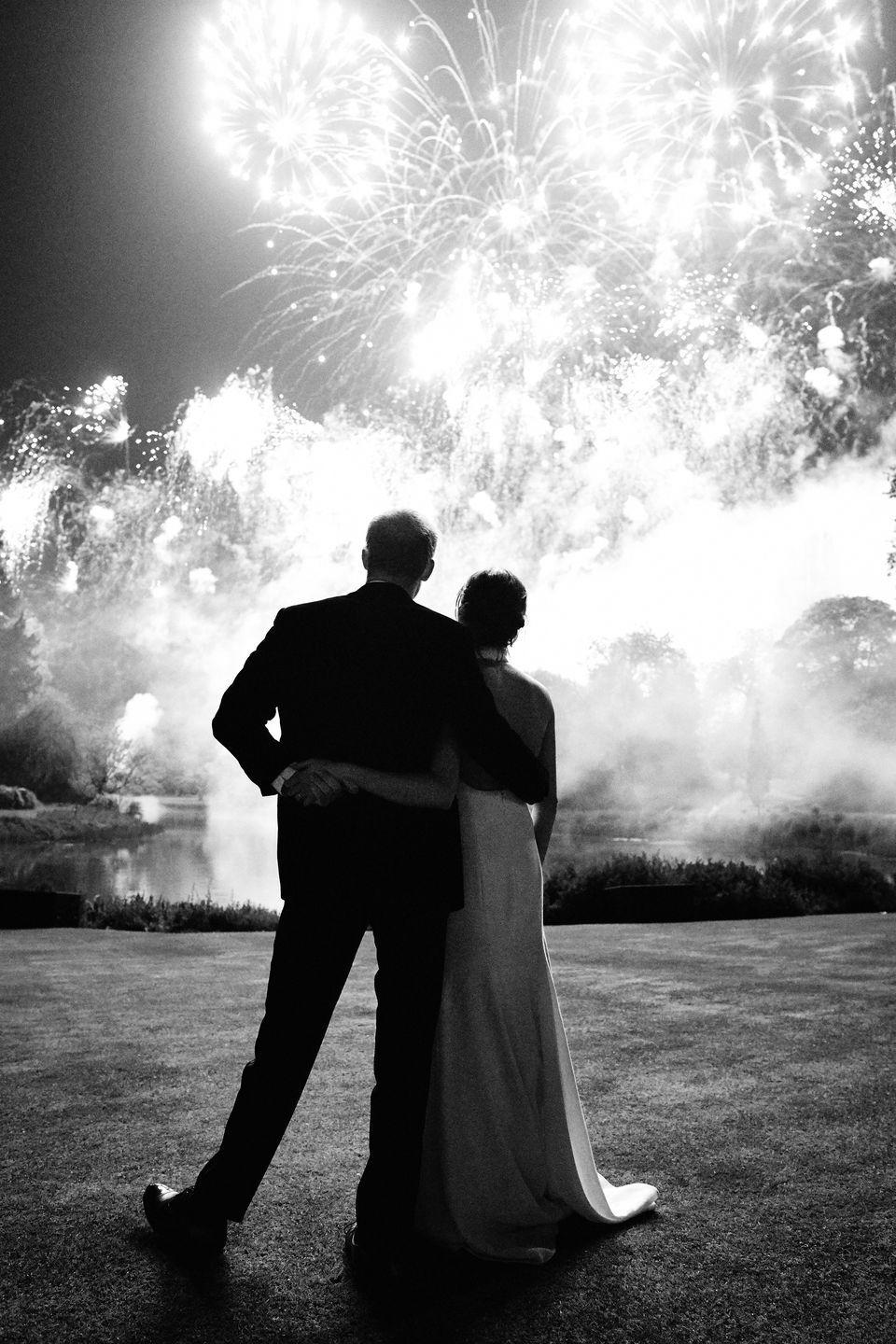 "<p>The Duke and Duchess of Sussex capped off an exciting year by sharing <a href=""https://www.townandcountrymag.com/society/tradition/a25584157/prince-harry-meghan-markle-frogmore-house-christmas-card-2018/"" rel=""nofollow noopener"" target=""_blank"" data-ylk=""slk:an intimate black and white photograph from their wedding celebration as their 2018 Christmas Card"" class=""link rapid-noclick-resp"">an intimate black and white photograph from their wedding celebration as their 2018 Christmas Card</a>. The heart-warming shot features the couple embracing at their wedding reception at Frogmore House while watching fireworks— and features Meghan's now iconic white Stella McCartney wedding dress. </p>"