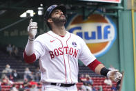 Boston Red Sox's J.D. Martinez celebrates his solo home run In the second inning of a baseball game against the Chicago White Sox at Fenway Park, Monday, April 19, 2021, in Boston. (AP Photo/Elise Amendola)