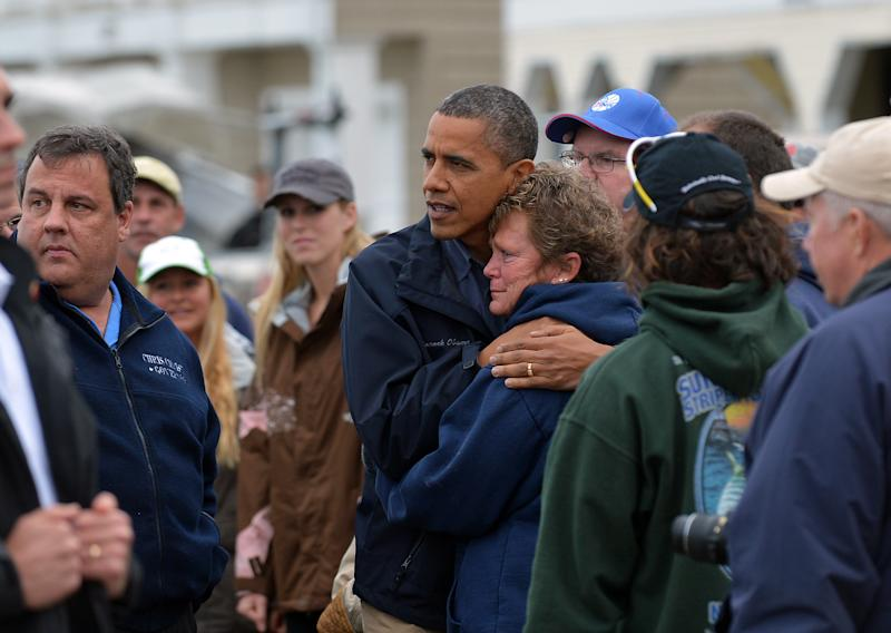 US President Barack Obama comforts Hurricane Sandy survivor in Brigantine, New Jersey, on October 31, 2012. (JEWEL SAMAD via Getty Images)