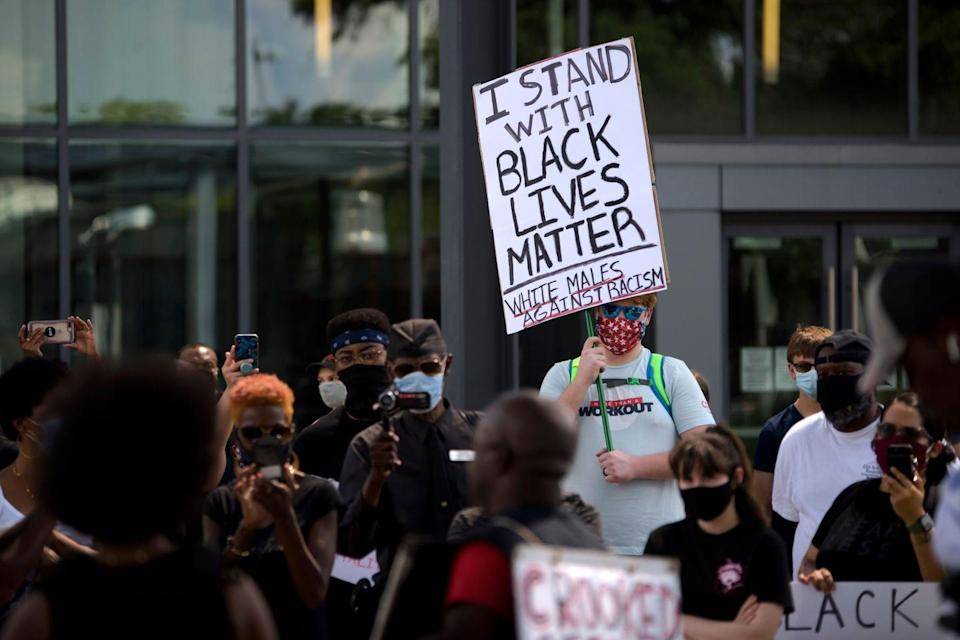 <p>A white man stands for Black Lives Matter and against racism in Texas. </p>