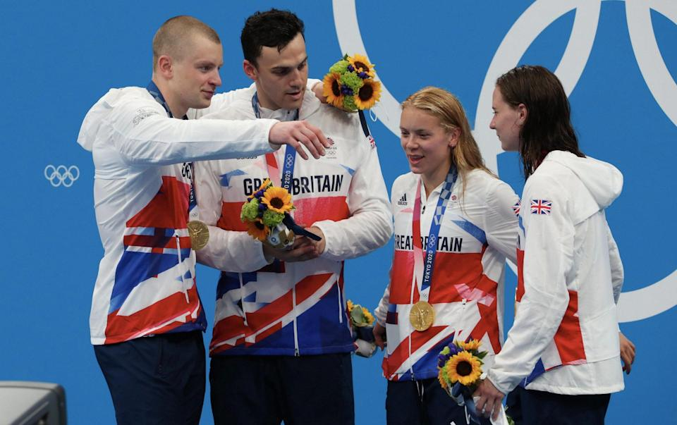 Gold medallists Adam Peaty, James Guy, Anna Hopkin and Kathleen Dawson of Team Great Britain poses during the medal ceremony for the Mixed 4 x 100m Medley Relay Final at Tokyo Aquatics Centre on July 31, 2021 in Tokyo, Japan. - GETTY IMAGES