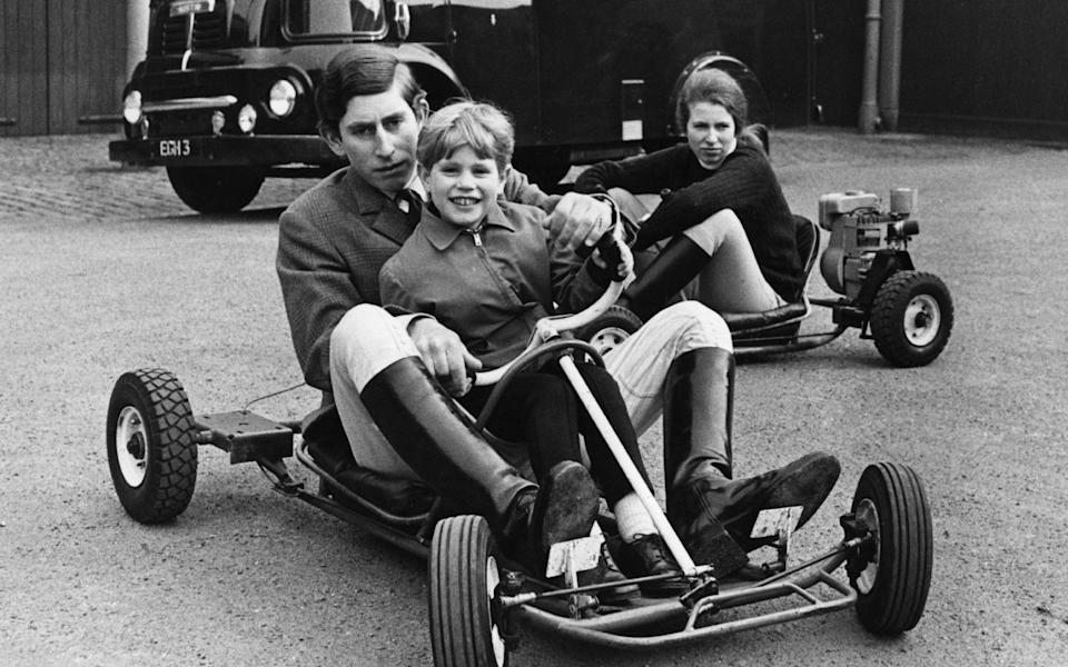 April 1969: Charles, Prince of Wales and Prince Edward riding together in go-kart whilst Princess Anne drives behind them - Hulton Archive