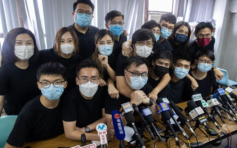 Pro-democracy campaigners and winners of primaries ahead of Hong Kong's Legislative Council elections in September pictured ahead of a press conference on Wednesday. - JEROME FAVRE/EPA-EFE/Shutterstock/Shutterstock
