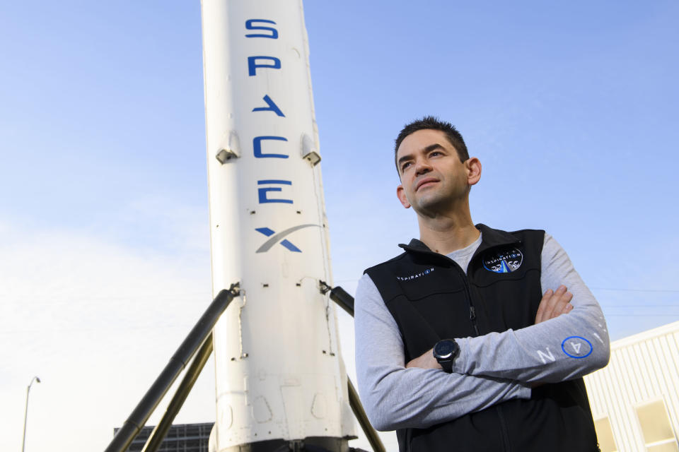 Inspiration4 mission commander Jared Isaacman, founder and chief executive officer of Shift4 Payments, stands for a portrait in front of the recovered first stage of a Falcon 9 rocket at Space Exploration Technologies Corp. (SpaceX) on February 2, 2021 in Hawthorne, California. - Isaacman's all-civilian Inspiration4 mission will raise $200 million for St. Jude Children's Research Hospital through a donation based sweepstakes to select a member of the crew. (Photo by Patrick T. FALLON / AFP) (Photo by PATRICK T. FALLON/AFP via Getty Images)