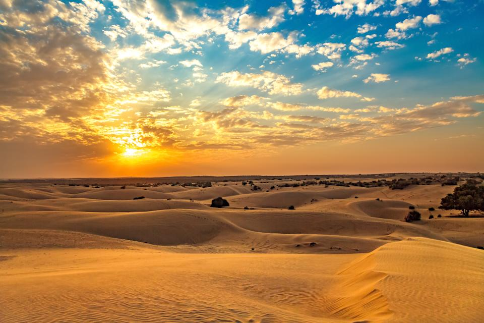 View of Thar desert sunset at Jaisalmer Rajasthan with moody vibrant sky