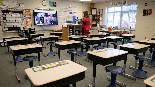 PHOTO: Fourth grade teacher Kelly Brant stands in her classroom as she talks to her students who were learning remotely, Jan. 19, 2021, at Park Brook Elementary School in Brooklyn Park, Minn. (Christine T. Nguyen/Minnesota Public Radio via AP, FILE)