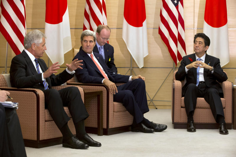 U.S. Secretary of Defense Chuck Hagel, left, and U.S. Secretary of State John Kerry, second left, meet with Japanese Prime Minister Shinzo Abe at Kantei, the Prime Minister's Official Residence, in Tokyo Thursday Oct. 3, 2013. Kerry and Hagel are in Tokyo to attend the Japan-US security meeting held earlier in the day with their Japanese counterparts. (AP Photo/Jacquelyn Martin, Pool)